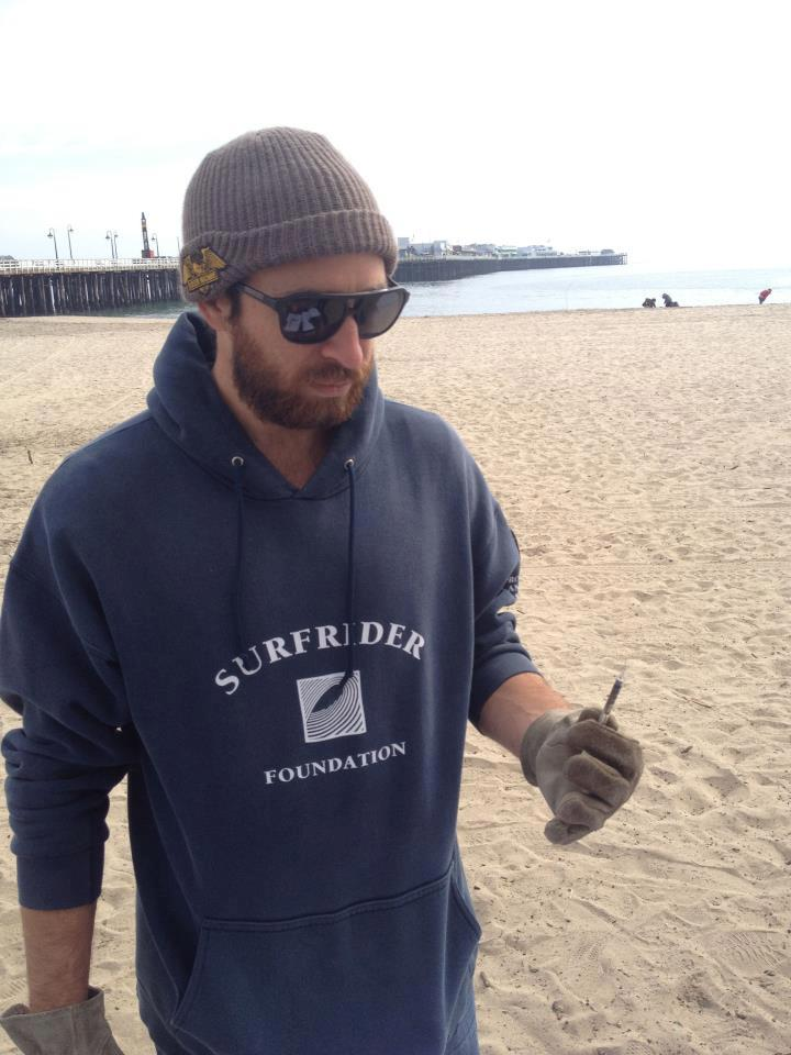 Trey removing 1 of 10 needles from our February beach clean up in 2013.